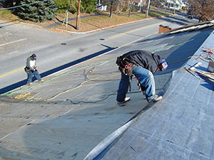 Roof Worker doing Residential Roof Repair